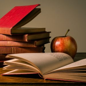 Teachers books and an apple