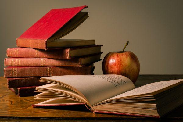Teachers books and an apple